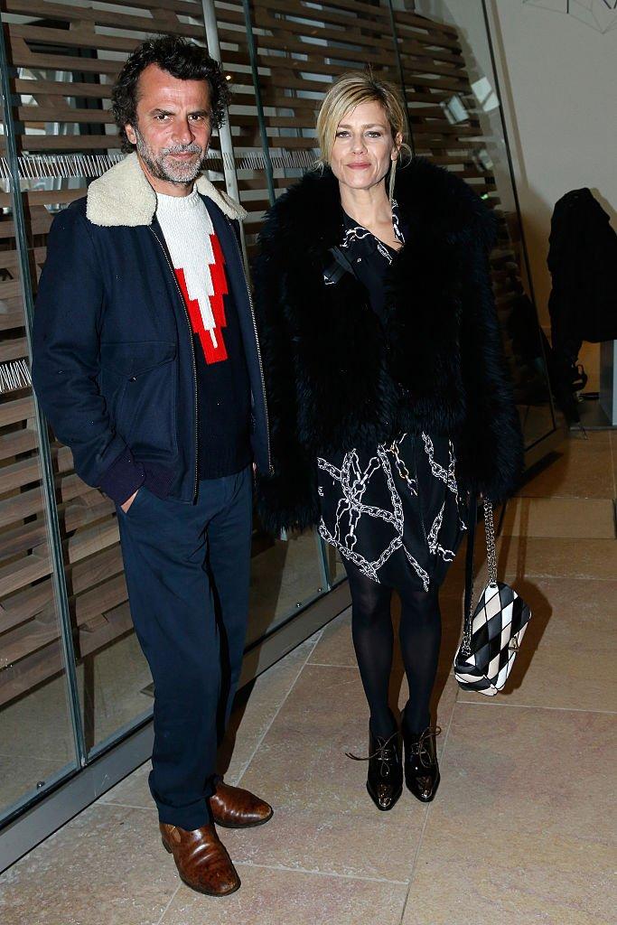 Éric Lartigau and Marina Foïs à la Fashion Week à Paris, mars 2016. Photo : Getty Images