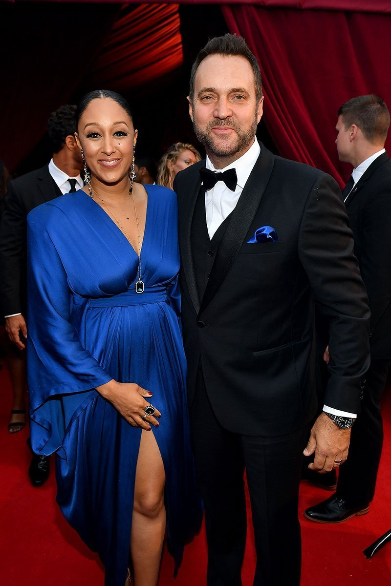 Tamera Mowry and Adam Housley attending Tyler Perry Studios' grand opening gala in Atlanta, Georgia in October 2018. | Source: Getty Images.