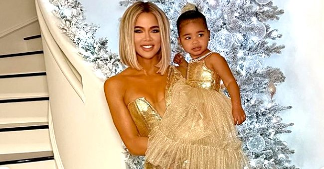 Khloé Kardashian and Daughter True Thompson Match in Stunning Gold Dresses for Christmas Party