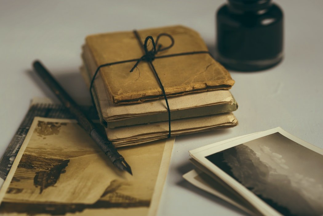 Old letters and photos from the old trunk   Source: Unsplash