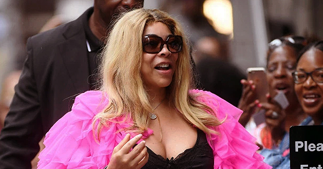 Wendy Williams Arrives at Work in Tight Dress & Ruffled Pink Coat
