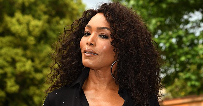 Angela Bassett Puts Her Cleavage & Hourglass Figure on Display in a Stylish Tight Black Dress