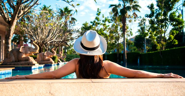 A woman soaking in a pool and enjoying the sun. | Photo: Shutterstock