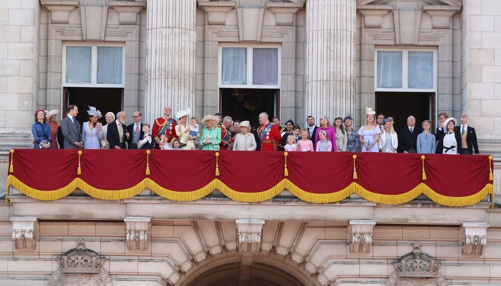 Queen Elizabeth II, Catherine, Duchess of Cambridge and Prince William, Duke of Cambridge, Meghan, Duchess of Sussex, Prince Harry, Duke of Sussex alongside other members of the royal family on the balcony of Buckingham Palace during Trooping The Colour. | Photo: Getty Images
