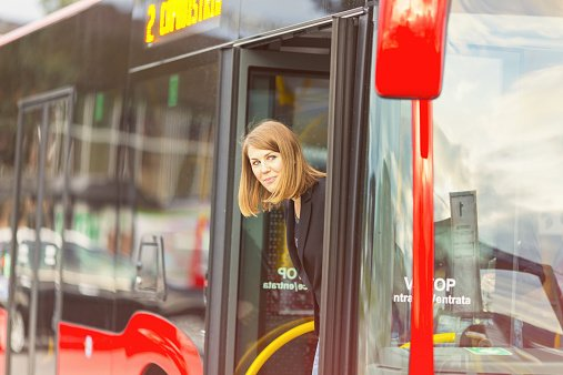 Photo of a young woman on the bus at the bus station. | Photo: Getty Images