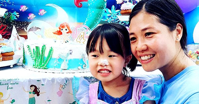 Angelina Liu sitting on her mother Pei Xia Chen Liu's lap at her mermaid-themed birthday party.   Source: twitter.com/NYPDdcer