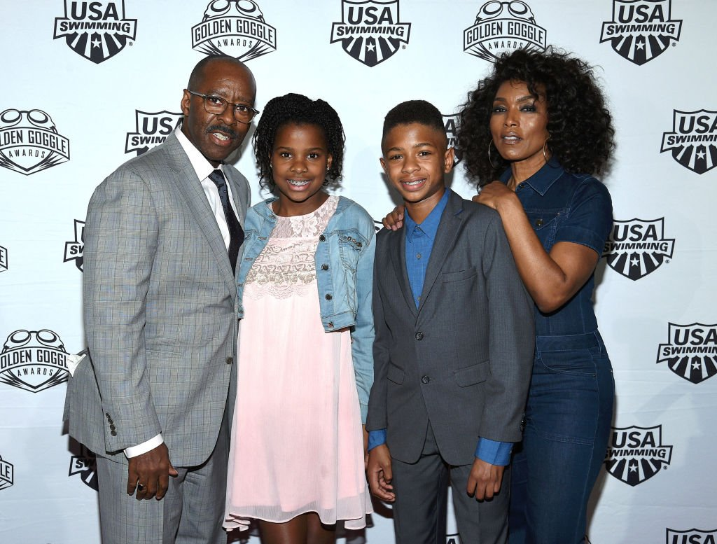 Courtney B. Vance, Bronwyn Vance, Slater Vance and Angela Bassett at the USA Swimming Golden Goggle Awards on Nov. 19, 2017, in California | Photo: Getty Images