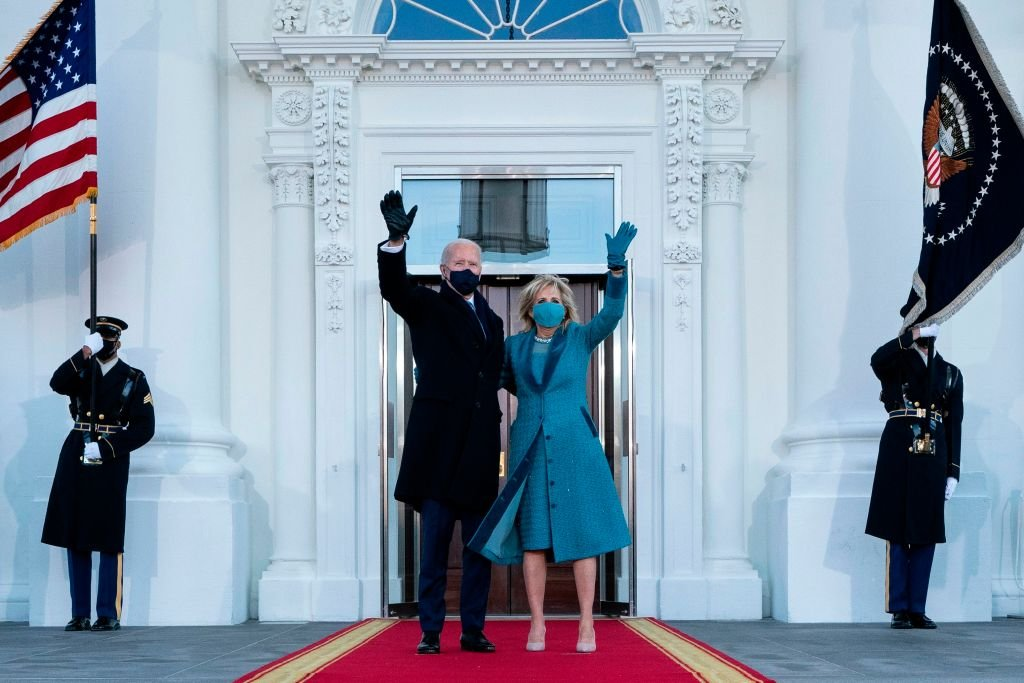 US President Joe Biden and First Lady Jill Biden wave as they arrive at the White House in Washington, DC, on January 20, 2021.   Photo: Getty Images