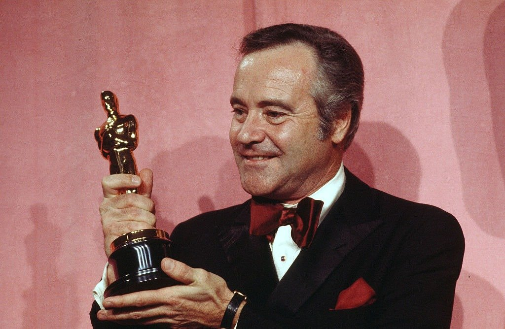 """Actor Jack Lemmon poses backstage after winning """"Best Actor"""" award during the 46th Academy Awards 