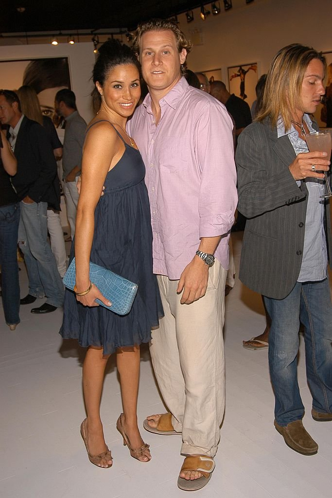 Meghan Markle and Trevor Engelson attend COACH Legacy Photo Exhibit on August 26, 2006, in East Hampton, NY. | Source: Getty Images.