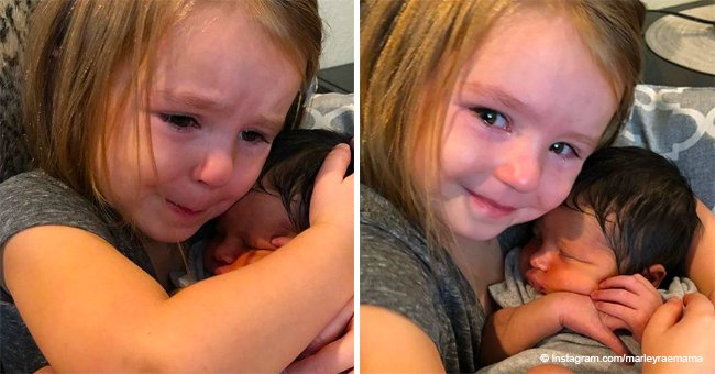 Little girl cuddles newborn cousin for the first time, and her adorable reaction goes viral