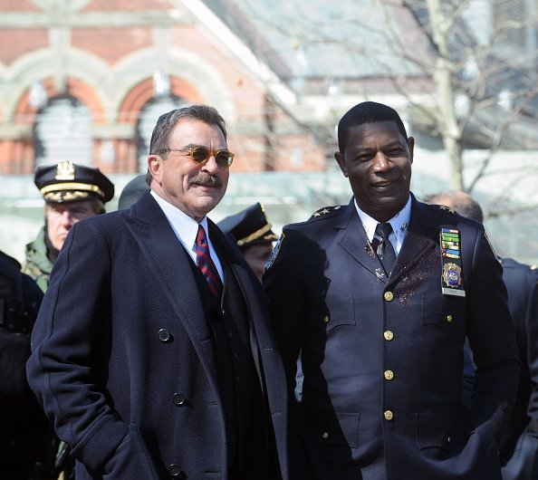 """Actors Tom Selleck and Dennis Haysbert on the set of """"Blue Bloods"""" on March 23, 2015 in New York City 