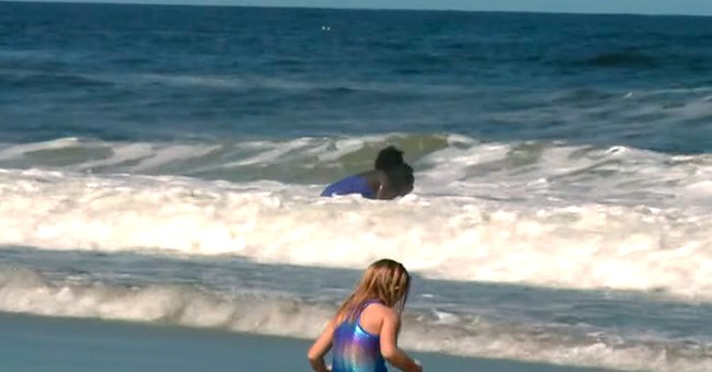 Image of a young girl walking by the ocean | Photo: YouTube/First Coast News