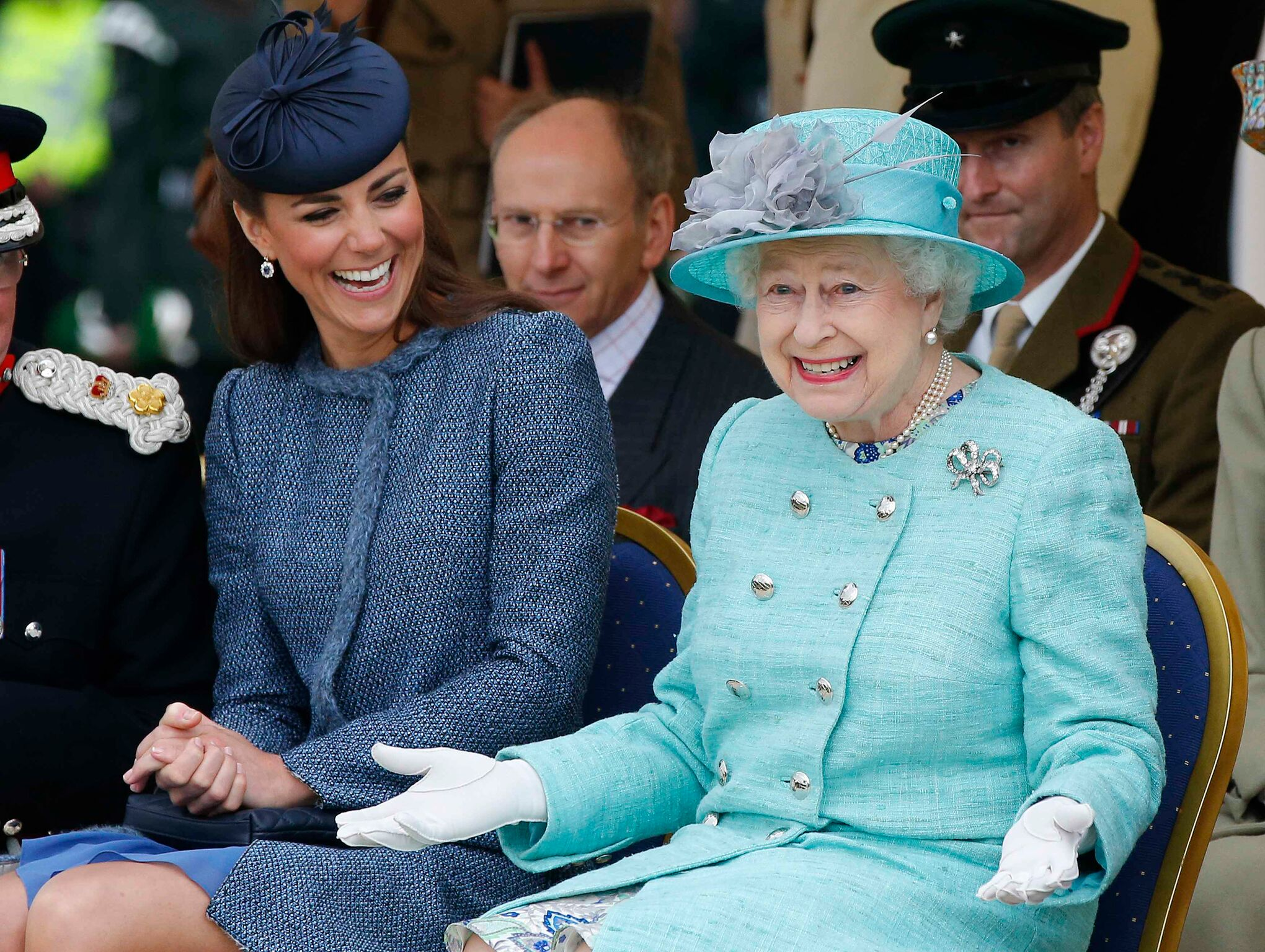 Duchess of Cambridge and Queen Elizabeth II watch part of a children's sports event | Getty Images / Global Images Ukraine