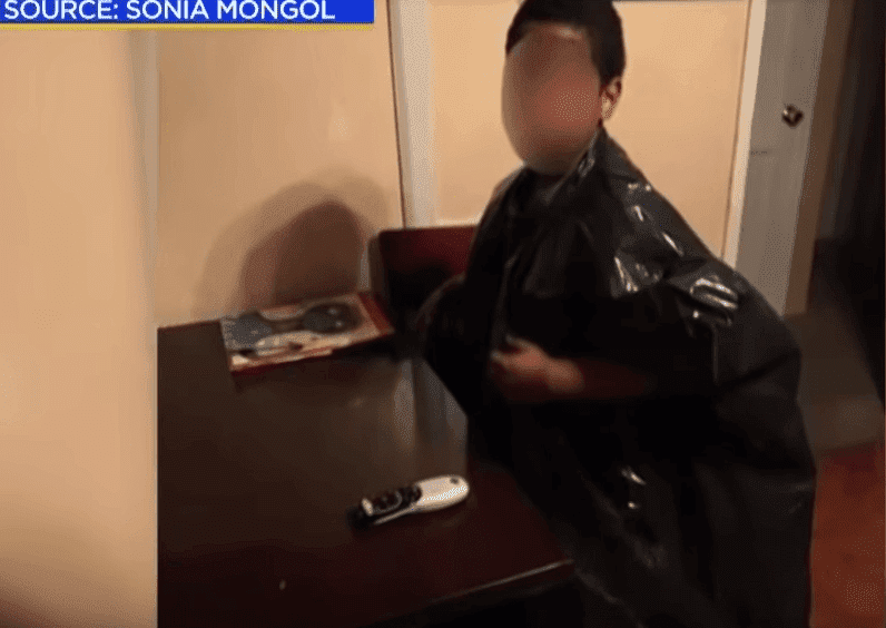 Screenshot of Sonia Mongol's son in the garbage bag he was made to wear at school. | Photo: YouTube/ CBS Los Angeles