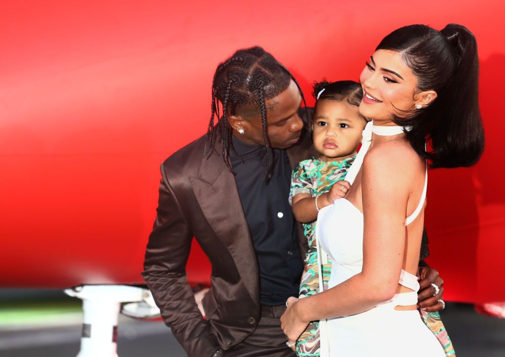"""Travis Scott, Stormi Webster, and Kylie Jenner during the Travis Scott: """"Look Mom I Can Fly"""" Los Angeles Premiere at The Barker Hanger on August 27, 2019 in Santa Monica, California. 