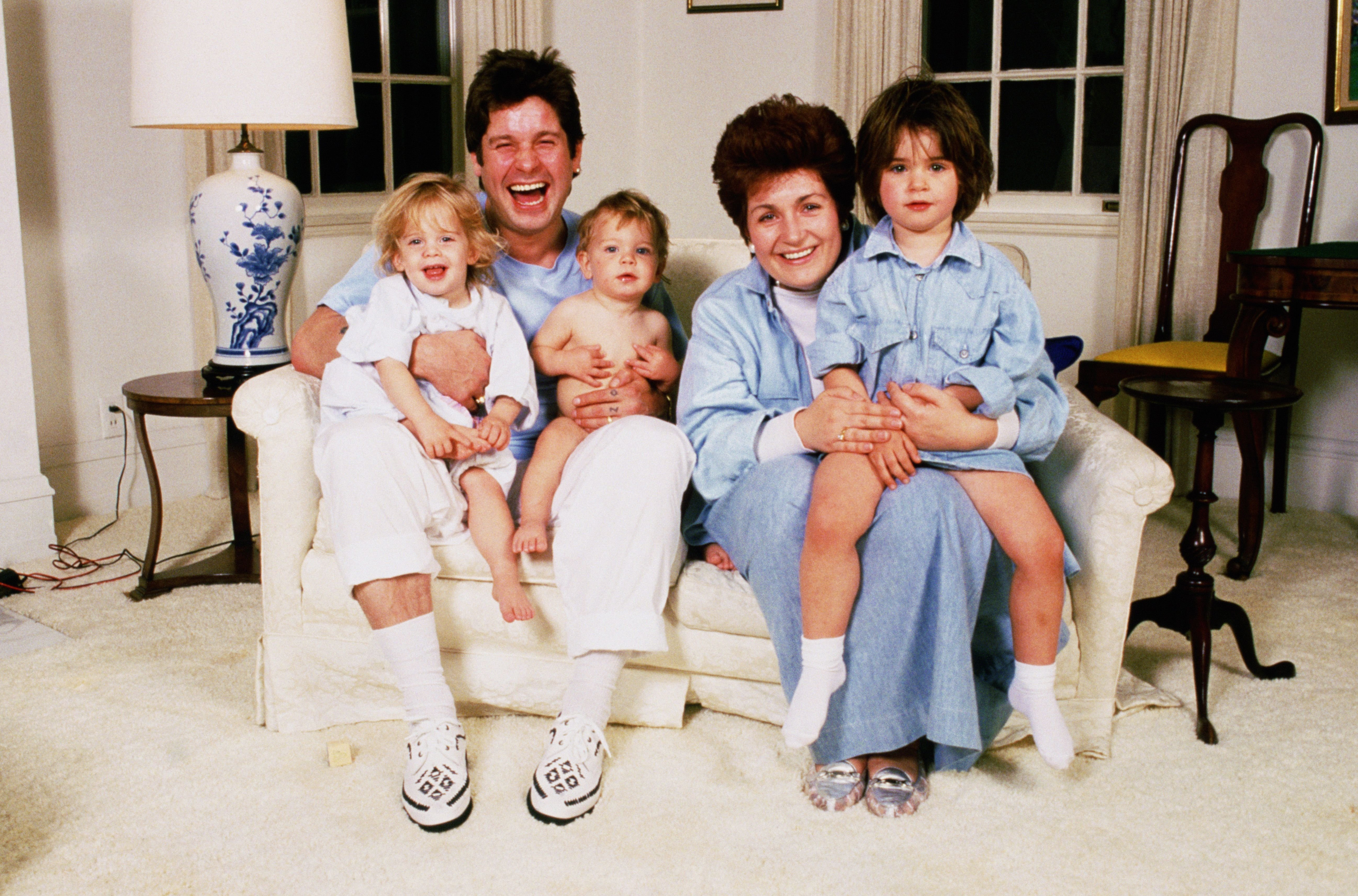 Ozzy and Sharon Osbourne at home with their children in early the 1990s | Source: Getty Images