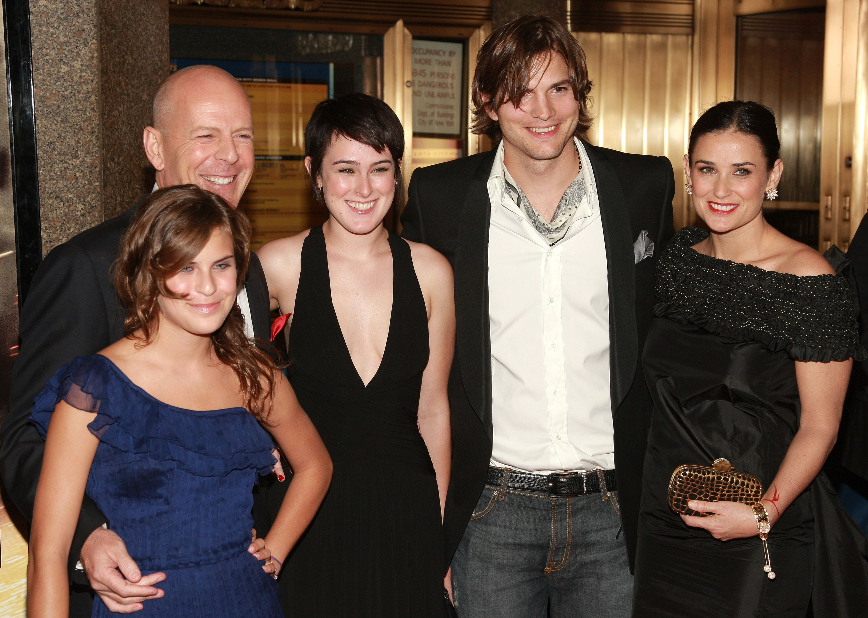 Ashton Kutcher, Demi Moore, and Bruce Willis pose with Rumer and Tallulah Willis at the premiere of Live Free Or Die Hard on June 22, 2007, in New York City   Photo: Evan Agostini/Getty Images