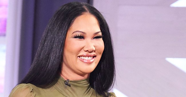 Kimora Lee Simmons' Daughter Ming Turns Heads Revealing Deep Cleavage in a Green Bikini