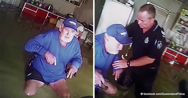 Policías rescatan a anciano en silla de ruedas atrapado por inundación en conmovedor video