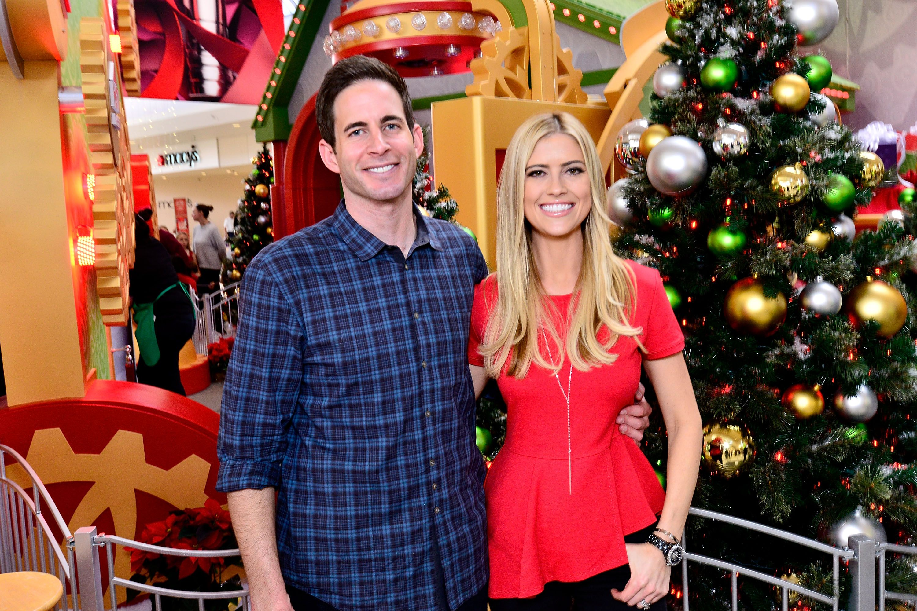 Tarek and Christina El Moussa, hosts of HGTV's hit show Flip or Flop, visited the HGTV Santa HQ at Lakewood Center on December 13, 2014 in Lakewood, California. | Source: Getty Images