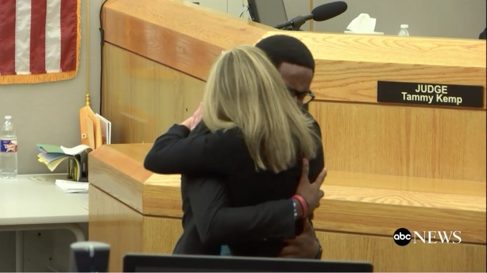 A screenshot of Brandt Jean hugging Amber Guyger at the Court Room after her Conviction | Source: Twitter / ABC News