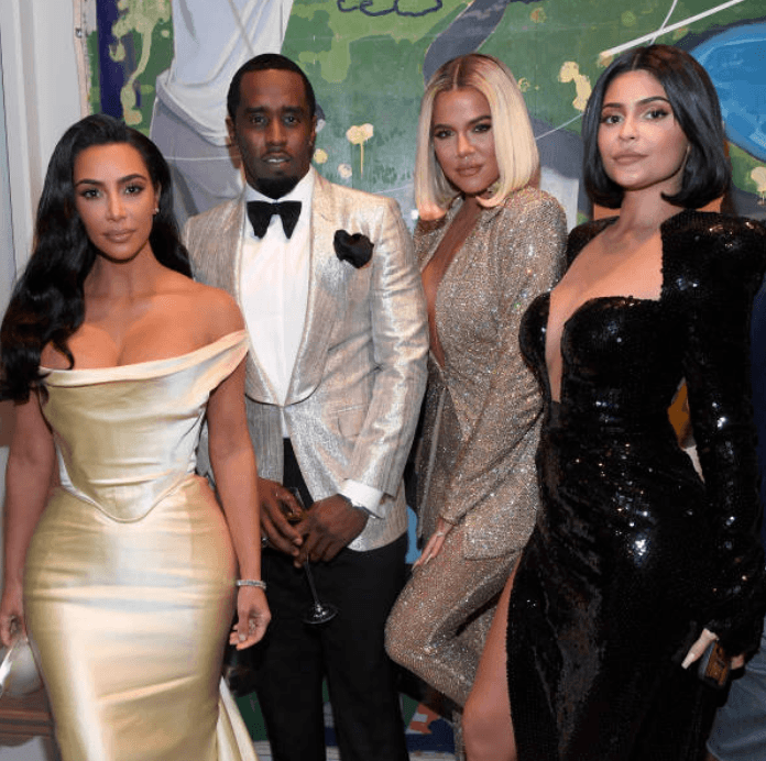 "Kim Kardashian, ""P. Diddy"" Sean Combs, Khloe Kardashian, and Kylie Jenner pose together at ""P. Diddy's"" 50th Birthday party, on December 14, 2019, in Los Angeles, California 