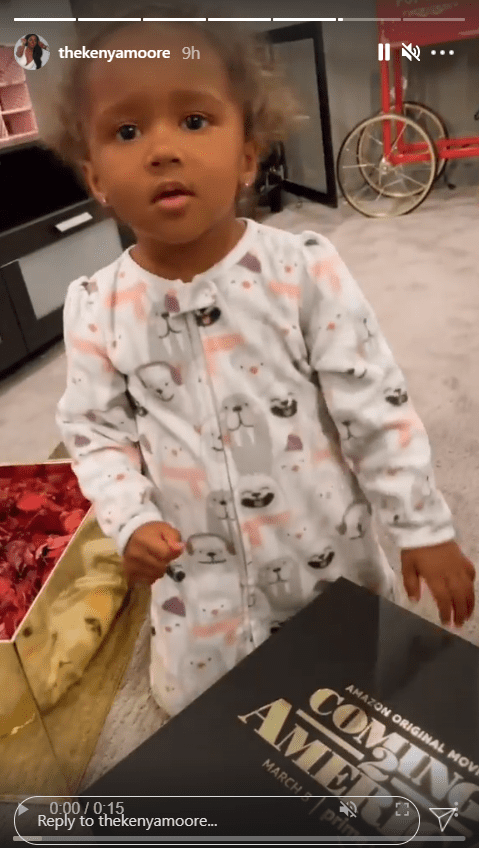 A screenshot from a clip of Brooklyn Daly adorably opening a box | Photo: Instagram/thekenyamoore