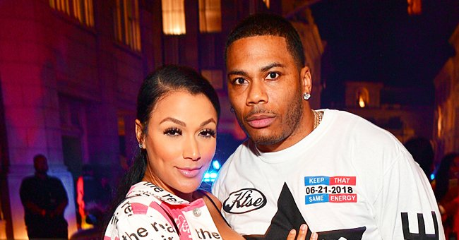 Nelly's Girlfriend Rocks a Checkered Jacket, Ripped Shorts & High Heels in Stunning Photos