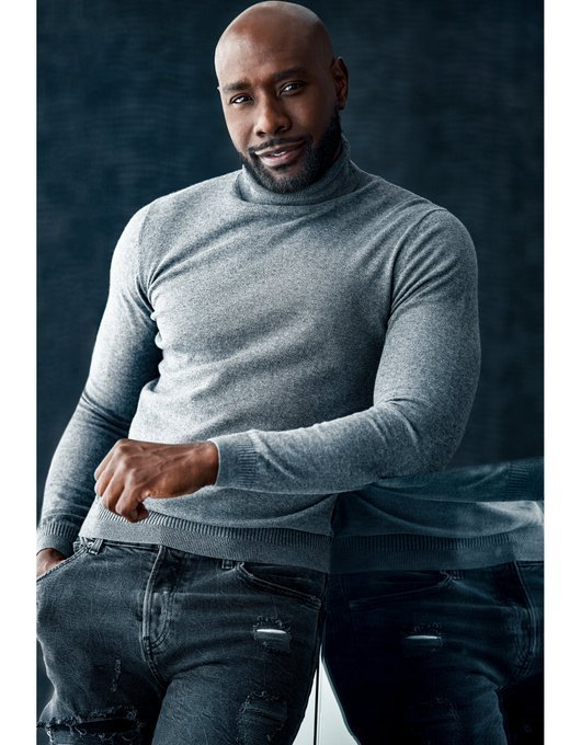 Source: Twitter / Morris Chestnut / Morris Chestnut leans against a mirrored surface in a grey turtleneck sweater and jeans