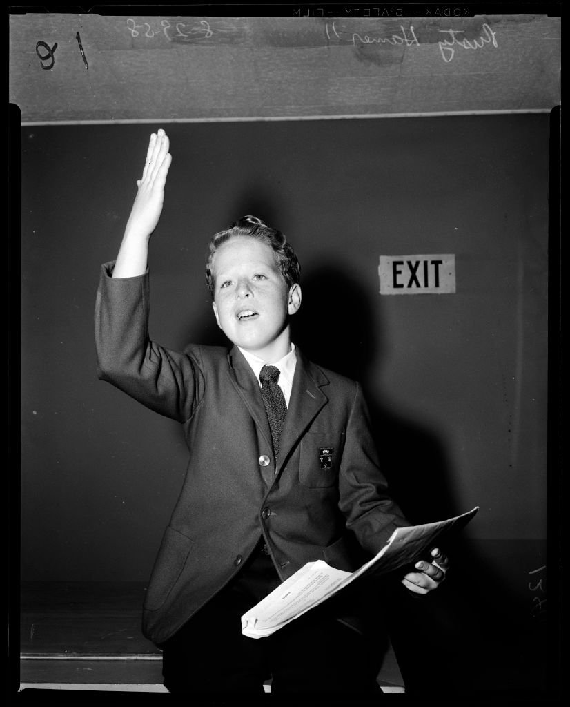 A portrait of Rusty Hamer holding a document in his hand on January 01, 1958   Photo: Getty Images