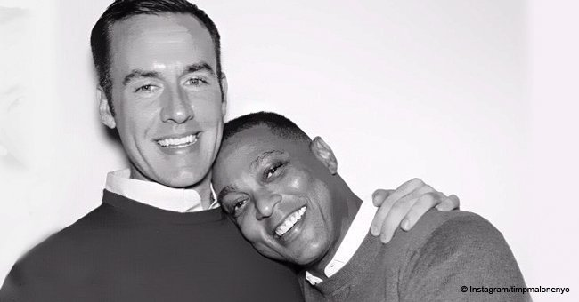 Don Lemon and his boyfriend flash sweet smiles while cuddling
