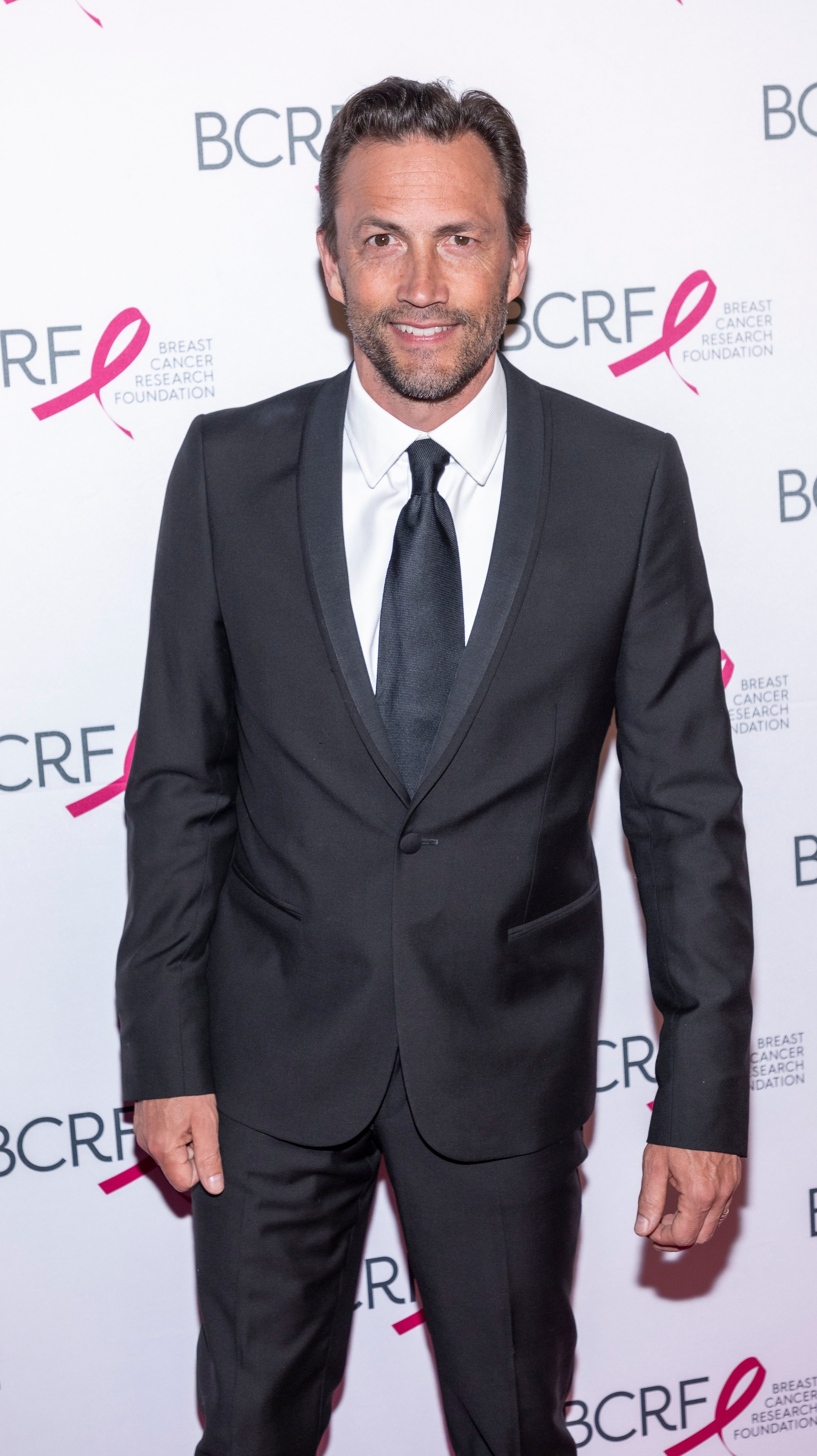 Andrew Shue pictured at the BCRF Hot Pink Party, 2019. | Photo: Shutterstock