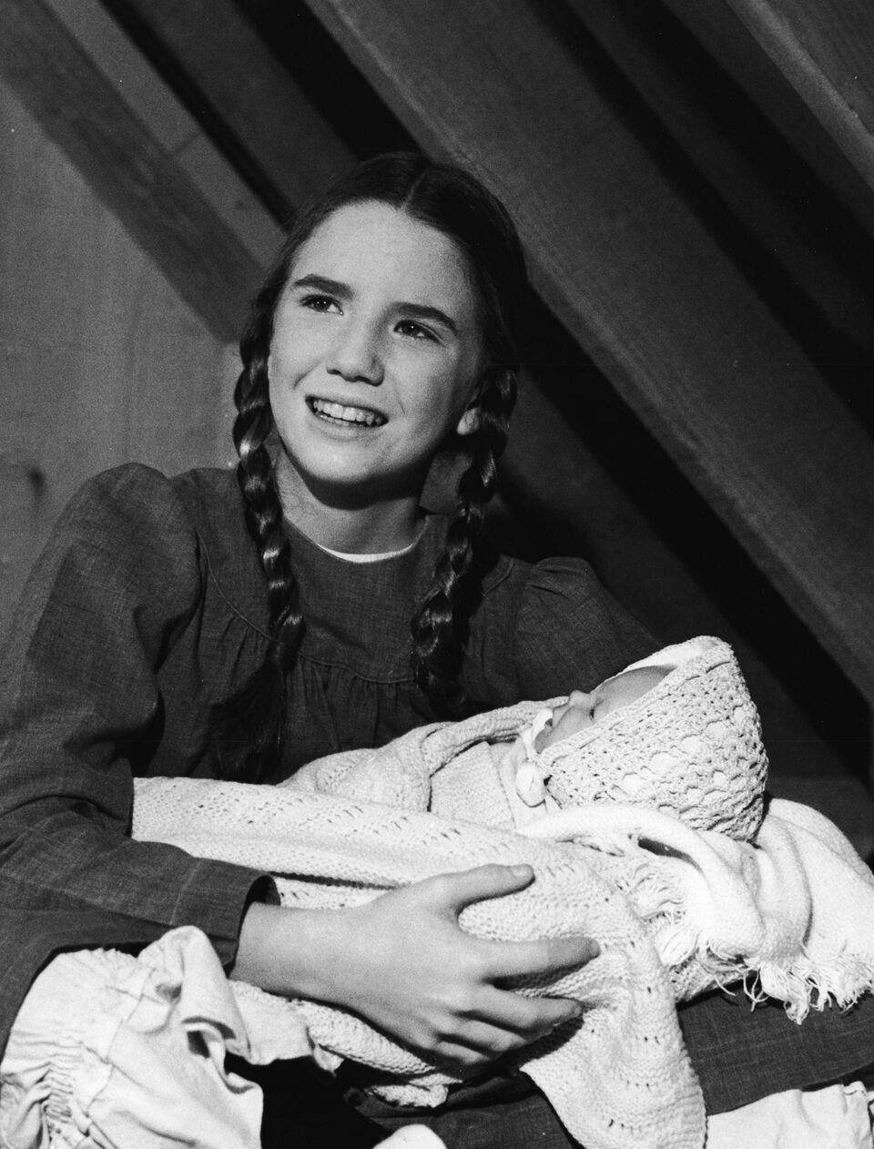 """Melissa Gilbert holds a baby doll in a scene from """"The Little House on the Prairie.""""   Source: Getty Images"""