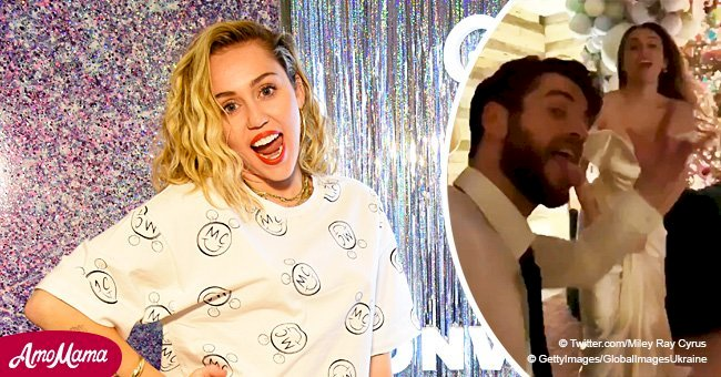 Miley Cyrus bares her shoulders in plunging slinky dress while dancing in a post-wedding video