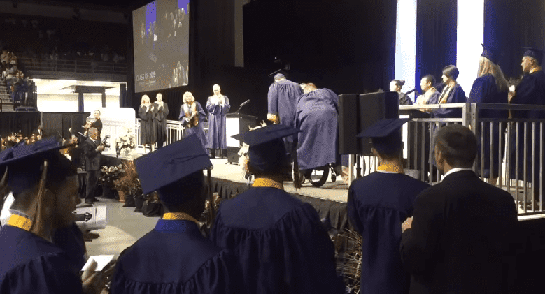 Kolton Smith, the paralyzed high school student walking to receive diploma on stage.| Photo: Facebook/ Hillsborough County Public Schools.
