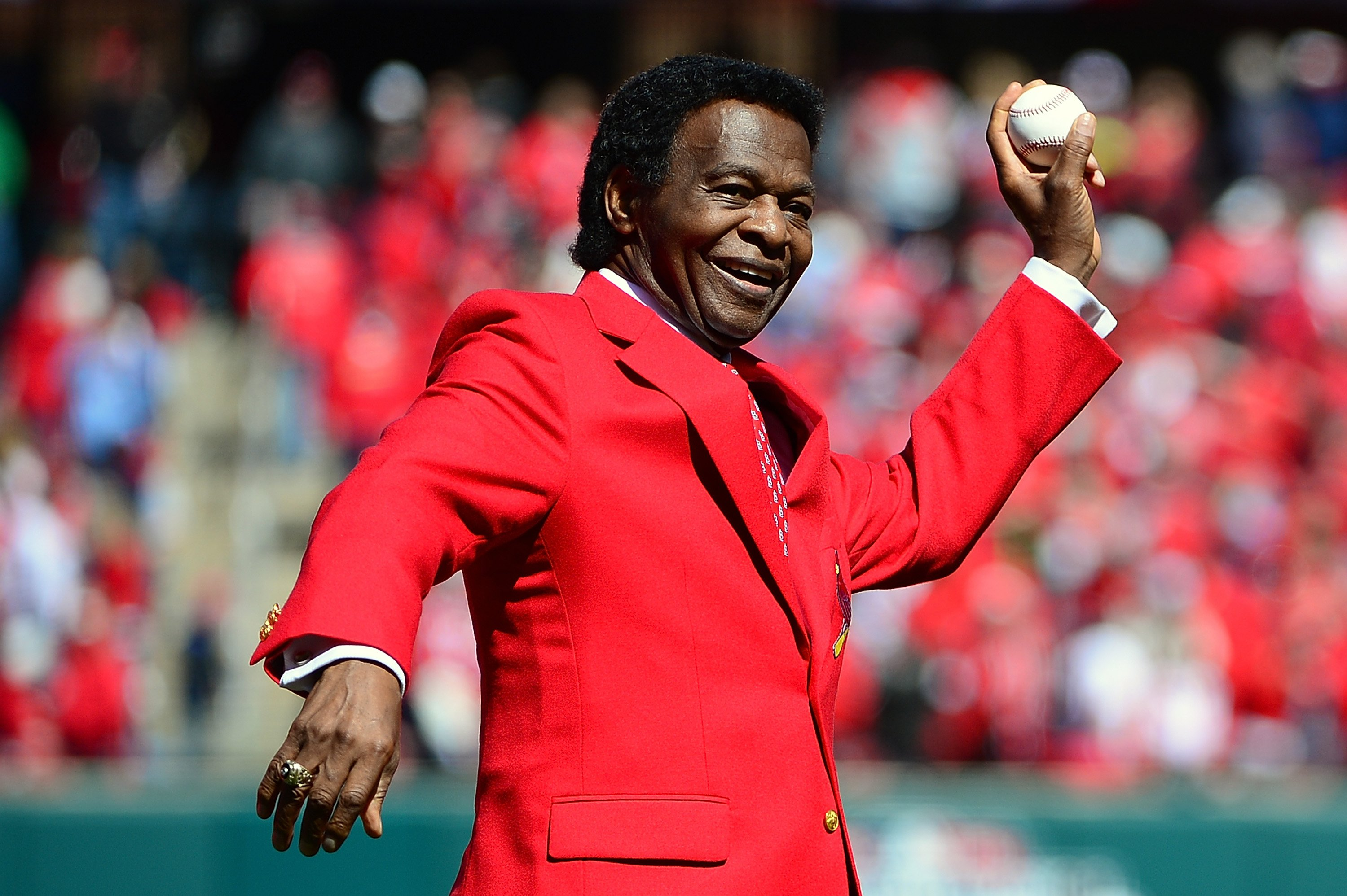 St. Louis Cardinals hall of famer Lou Brock throws out the first pitch at Busch Stadium on April 11, 2016 in St. Louis, Missouri. | Source: Getty Images