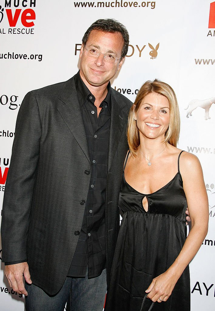 """Bob Saget and Actress Lori Loughlin arrive at the """"Much Love Animal Rescue Benefit"""" at the Playboy Mansion on July 14, 2007 in Los Angeles, California 