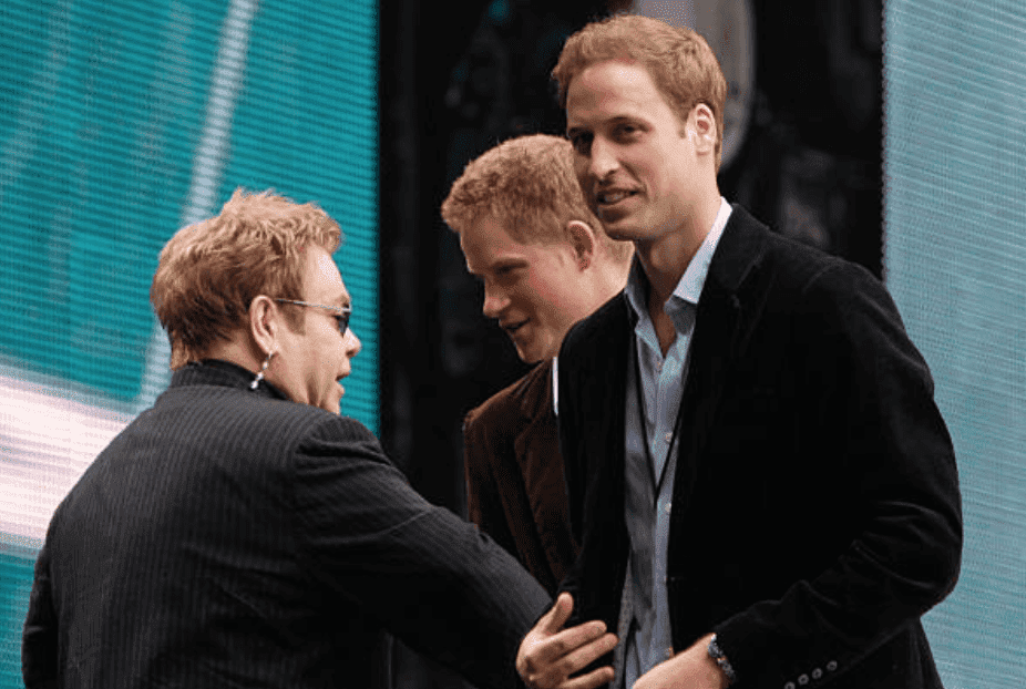 "Elton John greets and has a chat with Prince Harry and Prince William on stage during the ""Concert for Diana"" held at Wembley Stadium, on July 1, 2007,  London, England 