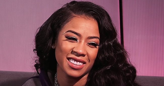 Keyshia Cole Turns up the Heat Showing Her Chest Tattoo in a Skimpy One-Piece Swimsuit & Floppy Hat