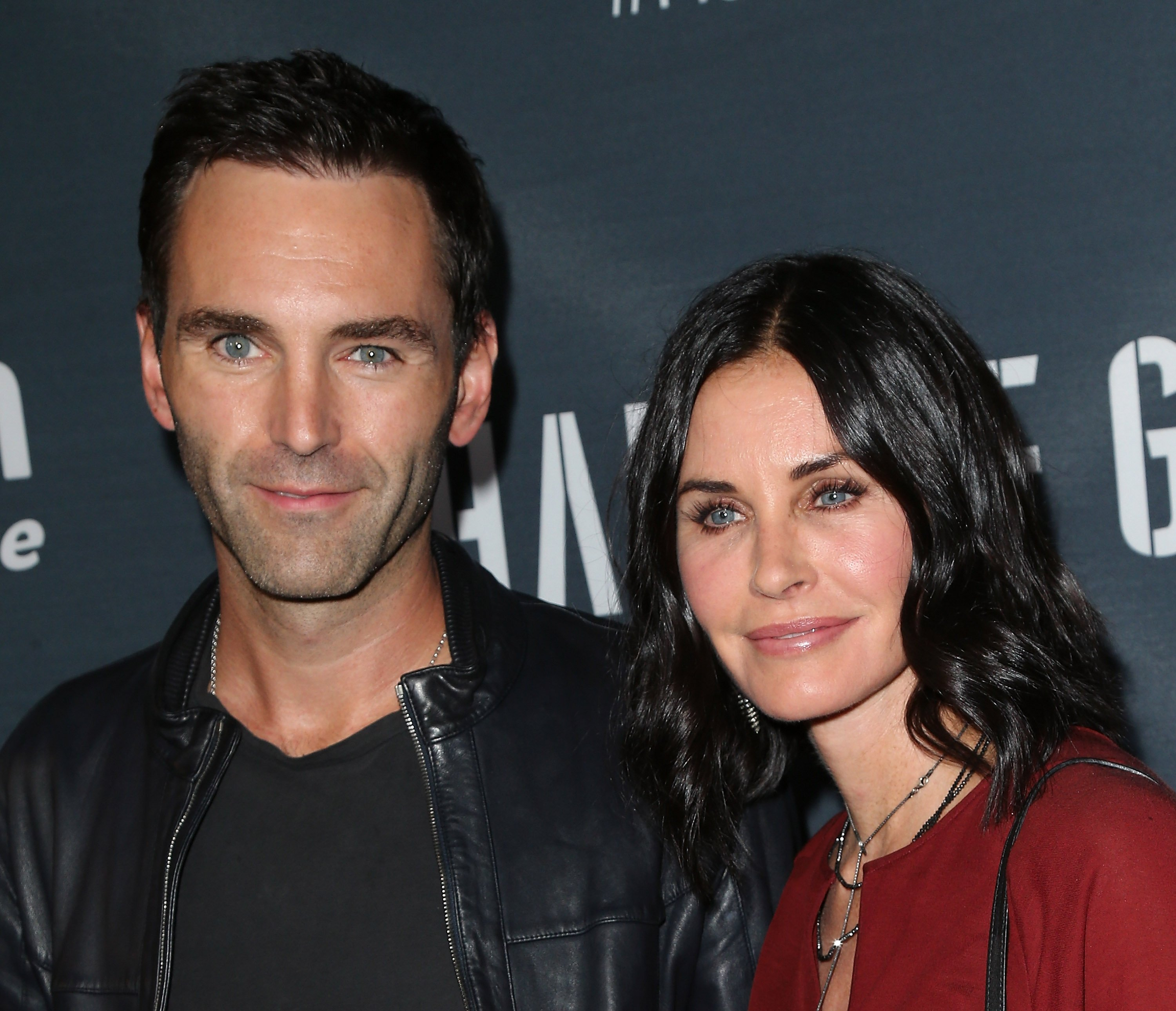 "Musician Johnny McDaid (L) and actress Courteney Cox attend the premiere of Amazon's Series ""Hand of God"" at Ace Theater Downtown LA on August 19, 2015, in Los Angeles, California. 