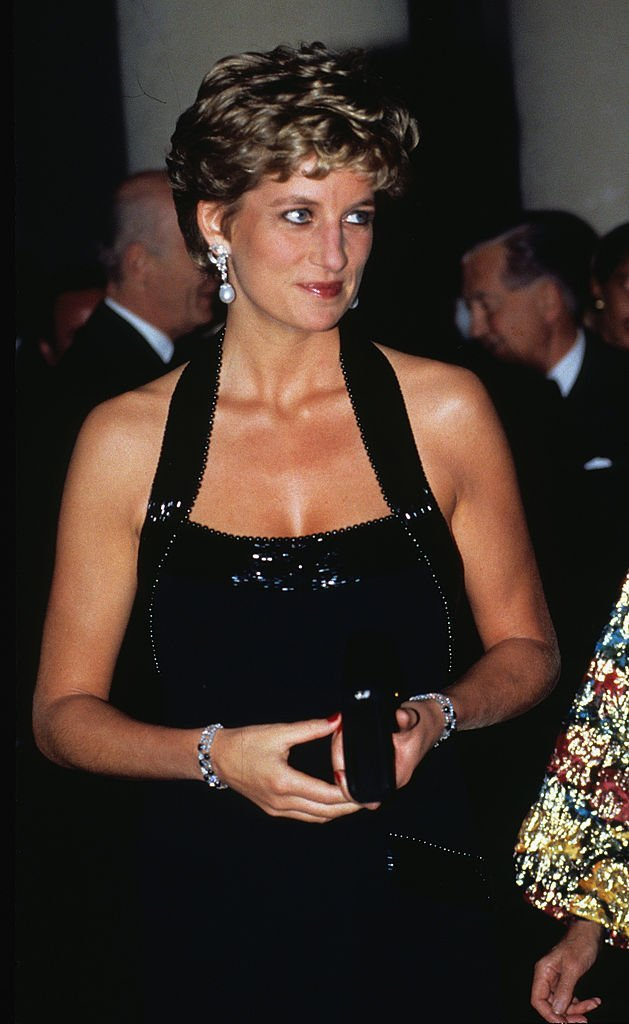 Diana, Princess of Wales wears a Catherine Walker evening gown | Getty Images