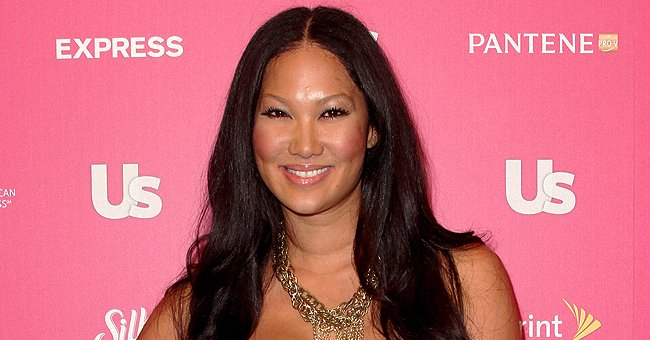 Kimora Lee Simmons Flaunts Her Curves in Black Baby Phat Leggings & Matching Jacket in Pic