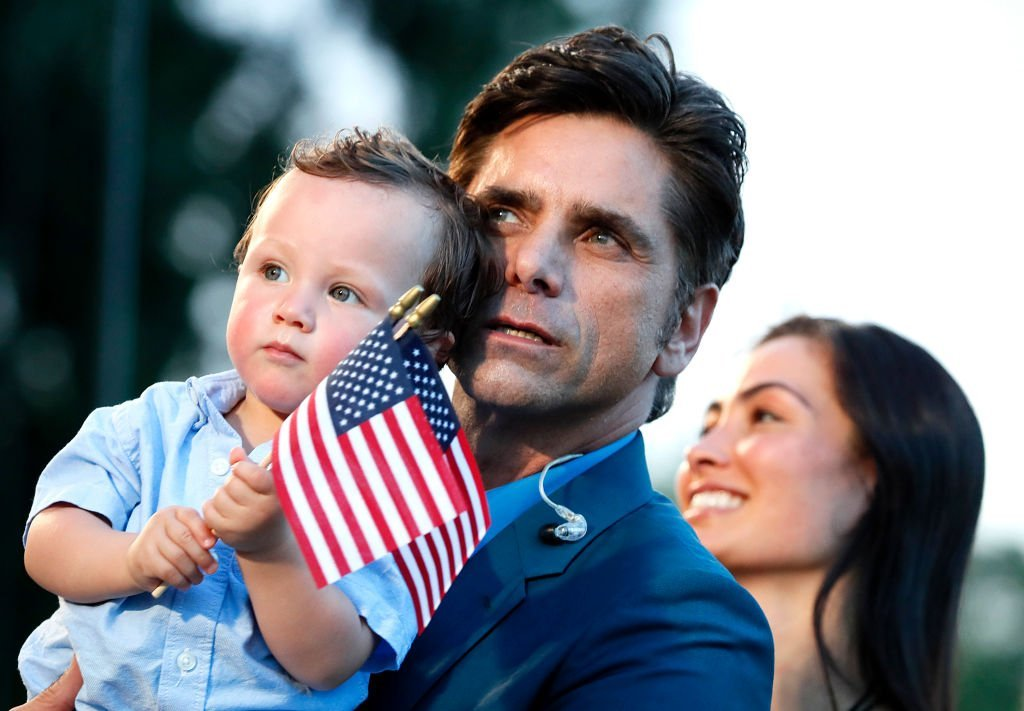 John Stamos & wife Caitlin McHugh with their son Billy Stamos during 'A Capitol Fourth' rehearsals on July 03, 2019 in Washington, DC. |Photo: Getty Images