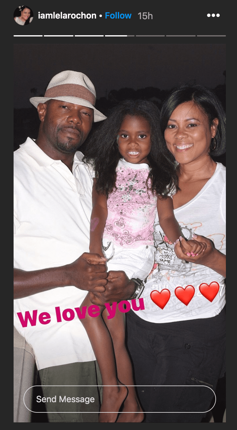 Lela Rochon, posing with her husband Antoine Fuqua as he carried their daughter, Asia Fuqua, in his arms   Source: instagram.com./iamlelarochon