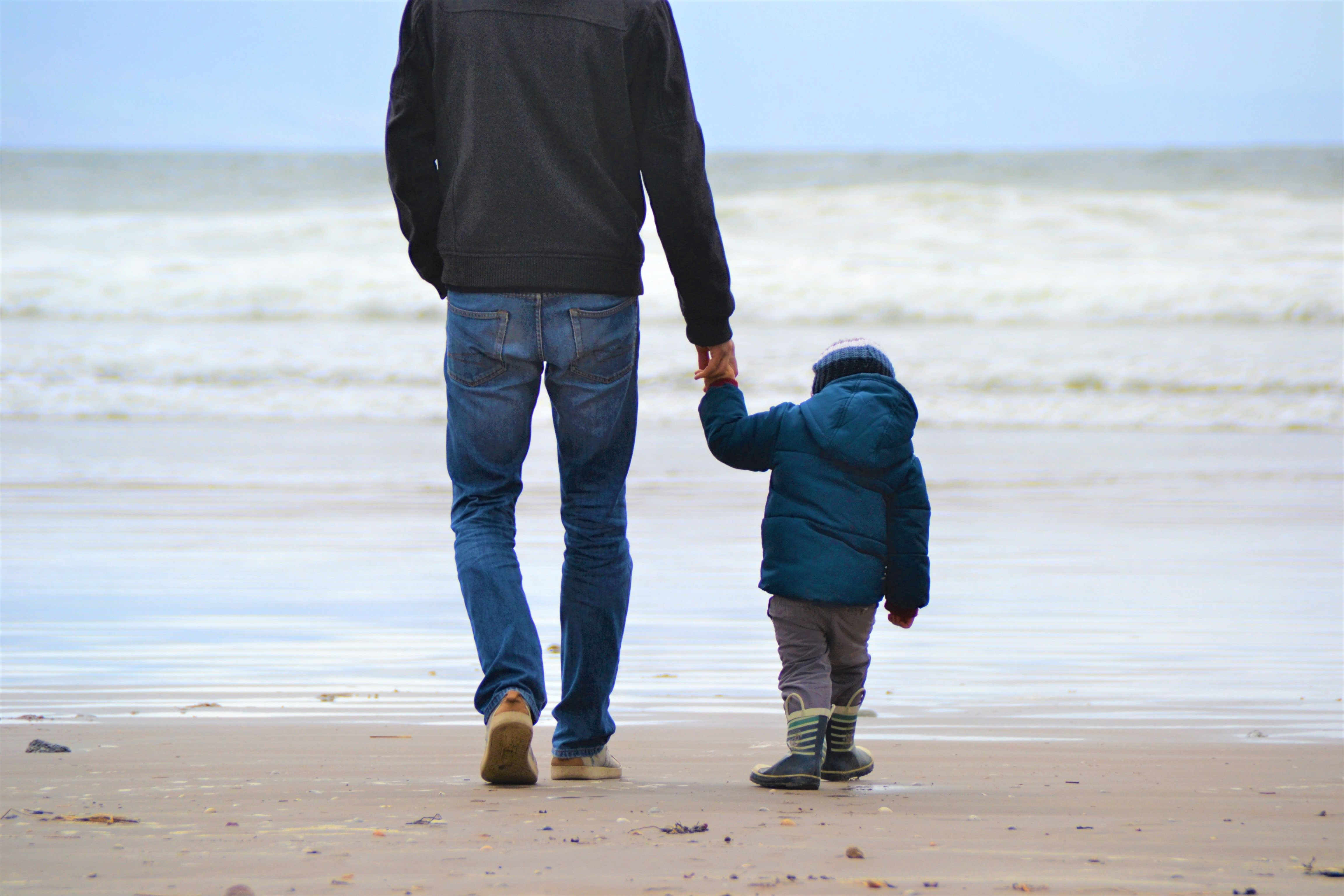 A father and son walking hand in hand | Source: Unsplash.com