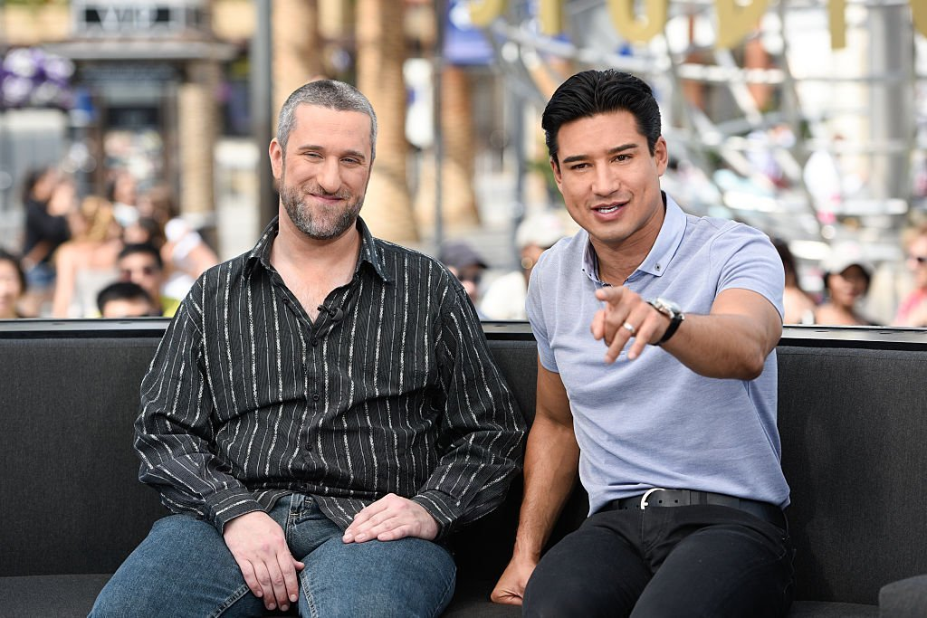 "Dustin Diamond  and Mario Lopez visit ""Extra"" at Universal Studios Hollywood on May 16, 2016 in Universal City, California 