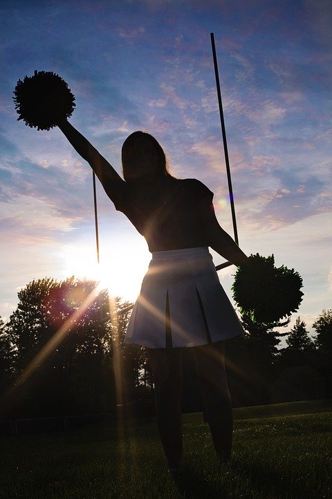A silhouette of a cheerleader.   Photo: Pixabay