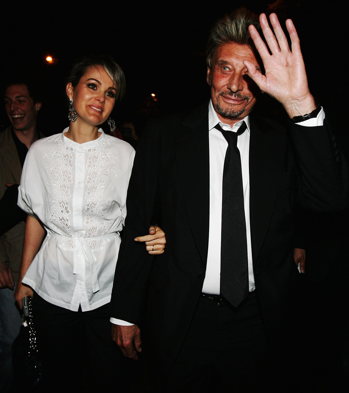 Johnny et Laeticia Hallyday main dans la main. l Source : Getty Images