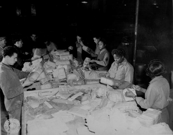 Women of all-black 6888th Central Postal Battalion sorting huge backlog of mail | Photo: GettyImages